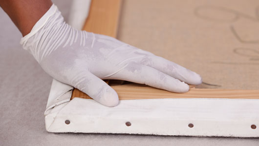 Gloved hand protecting a drawing