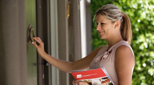Female coordinator knocking to her client's door