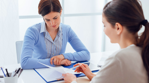 Consultant explaining moving insurance to client.